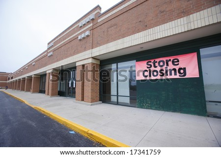 Store closing in suburban shopping center. - stock photo