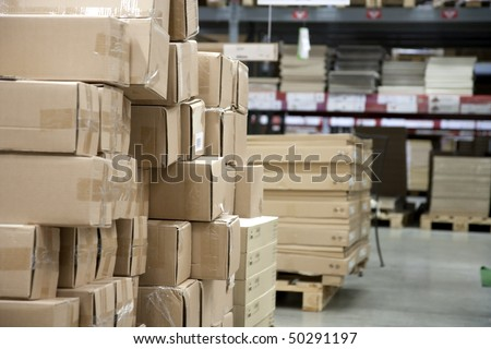 Store racks with product boxes - stock photo
