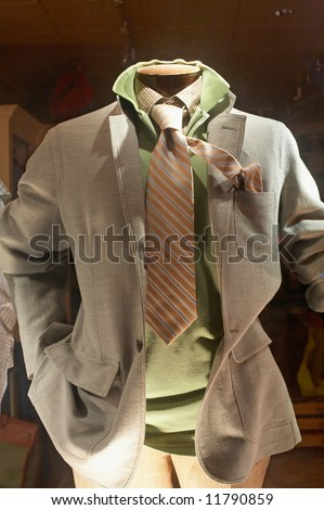 Storefront of upscale man's clothing store mannequin - stock photo