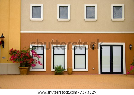 Storefront with sealed windows in beautiful pedestrian area. - stock photo