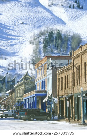 Storefronts and ski slope in the town of Aspen, Colorado - stock photo