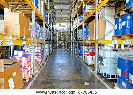 Storehouse corridor with goods and supplies at shelves - stock photo