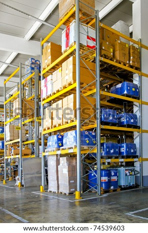 Storehouse with chemical liquids in cans and barrels - stock photo