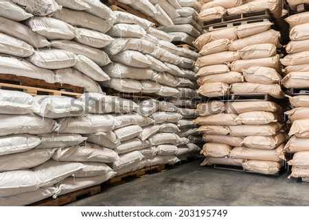 Storehouse with stacked sacks of chemical product. - stock photo