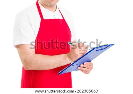 Storekeeper or shop administrator holding clipboard with checklist - stock photo