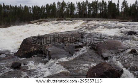 Storforsen, waterfall in the North of Sweden - stock photo