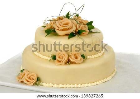storied cake with marzipan roses on white background