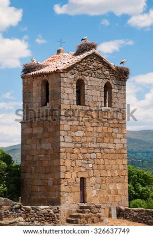 Storks in its nest in the belfry of a rural church - stock photo