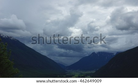 storm and dark clouds and summit of the mountains in the Alps