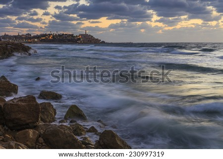 Storm at sunset near Tel Aviv - stock photo