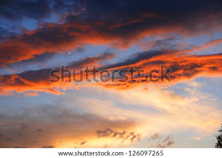 storm, bad weather clouds at sunset. - stock photo