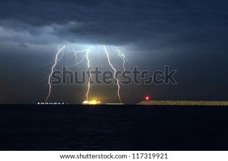 storm beginning with lightning - stock photo