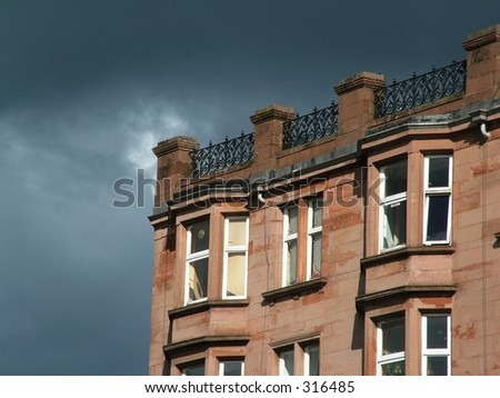 Storm Builds over Close up of Red brick house(2 of 2)