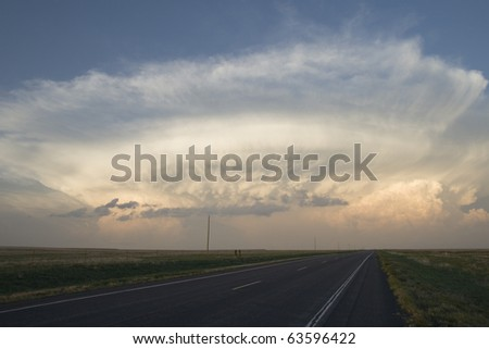 storm cloud above the horizon in the evening - stock photo