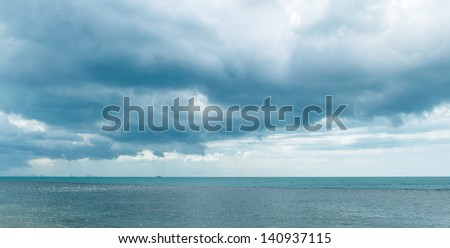 Storm cloud and sea - stock photo