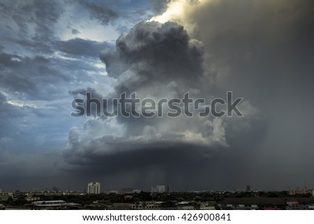 Storm cloude over city