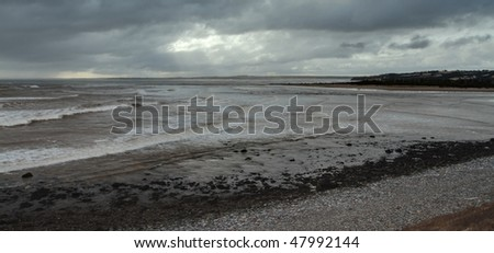 Storm clouds along the ocean shore - stock photo