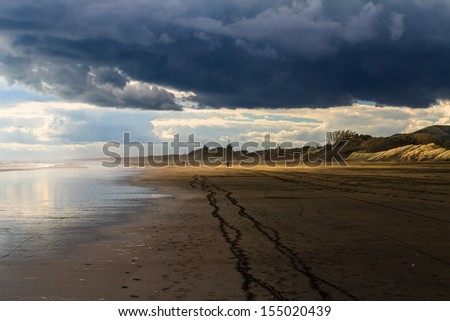 Storm Clouds at Muriwai Beach, Auckland, New Zealand - stock photo