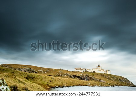 Storm clouds at Strathy Point lighthouse, Caithness, Scotland's first all electric lighthouse