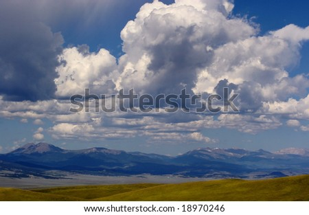 Storm clouds coming in over the Colorado Rocky Mountains - stock photo