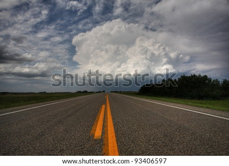 Storm clouds down a Saskatchewan highway - stock photo