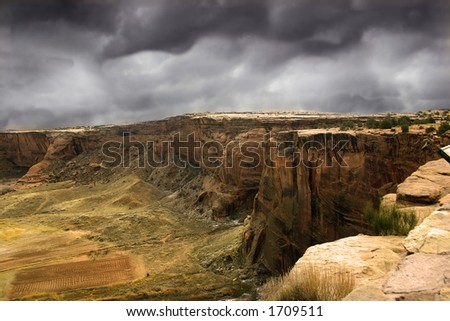 Storm clouds gather over Canyon de Chelly, land sacred to the modern Navajo Nation, just as it was to the ancient Anasazi. - stock photo
