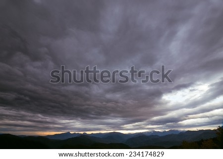 storm clouds on evening mountain - stock photo