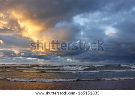 Storm Clouds Over a Lake Huron Beach at Sunset - Grand Bend, Ontario - stock photo