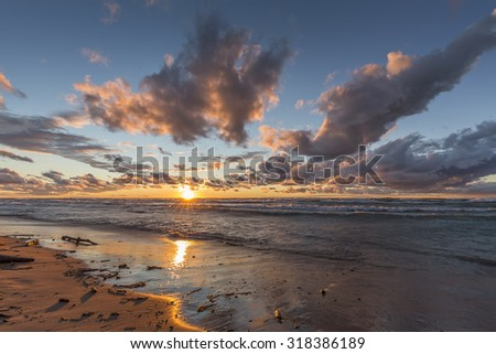 Storm Clouds Over a Sandy Beach at Sunset - Grand Bend, Ontario, Canada - stock photo