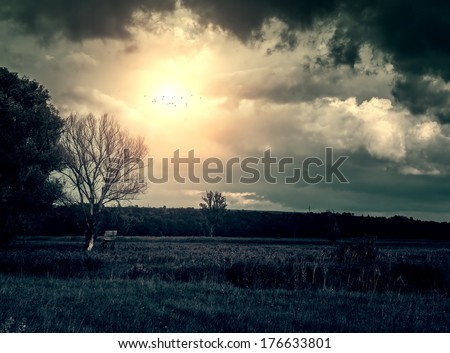 Storm clouds over beautiful landscape - stock photo