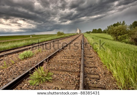 Storm Clouds over Grain Elevator Saskatchewan - stock photo