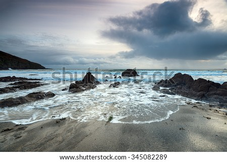 Storm clouds over Hemmick Beach on the south coast of Cornwall