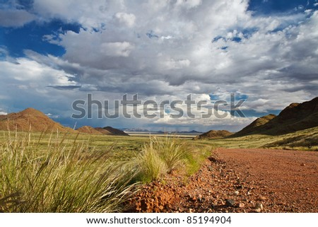 Storm clouds over landscape of Namibia - stock photo