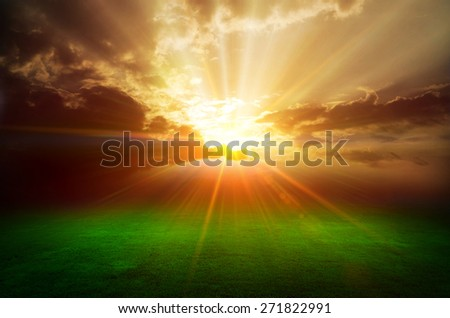 Storm clouds over meadow with green grass - stock photo