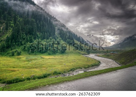 storm clouds over mountains and Indus river of ladakh, green valley sccenary,  Jammu and Kashmir, India - stock photo