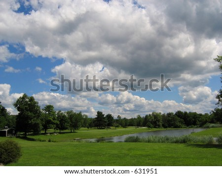 Storm Clouds Over Pond - stock photo