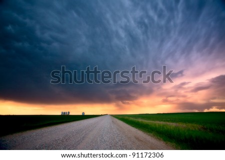 Storm Clouds over Saskatchewan country road - stock photo