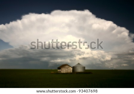 Storm clouds over Saskatchewan granaries - stock photo