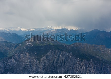 Storm clouds over the Dolomite mountains, view from mount Monte Baldo, Italy