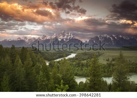 Storm clouds over the Tetons viewed from the Snake River Overlook - stock photo