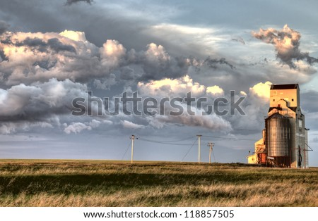 Storm Clouds Saskatchewan old grain elevator Canada - stock photo