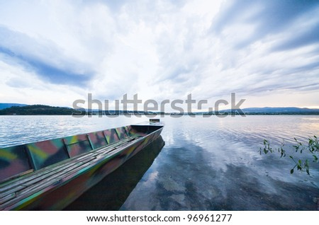 storm clouds with a boat on the lake