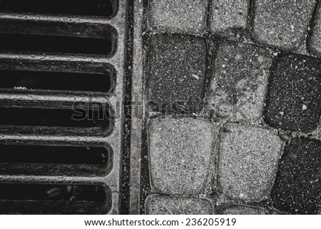 Storm drain closeup in black and white - stock photo