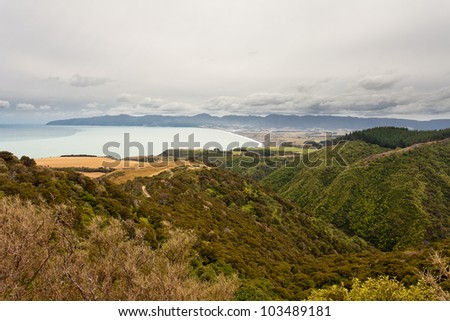 Storm forming over beautiful coastal landscape of Palliser Bay, Nort Island, New Zealand - stock photo