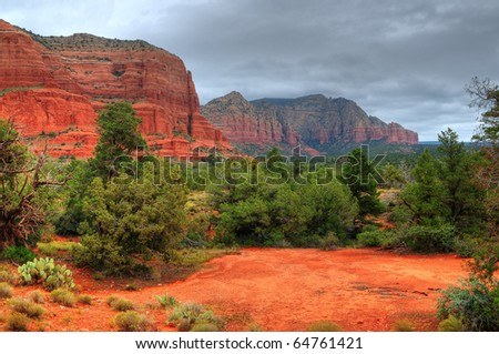 Storm forming over red rock country in Sedona, Arizona, USA - stock photo