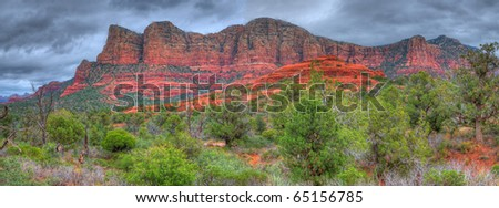Storm forming over red rock country Sedona, Arizona, USA panorama - stock photo