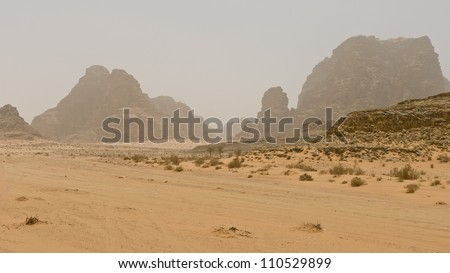 Storm in the desert of Wadi Rum, one of the world's most beautiful deserts located in southern Jordan. - stock photo