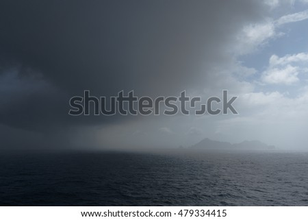 Storm in the sea over an isle.