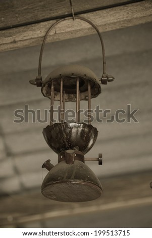 storm lanterns hanged on wooden  - stock photo
