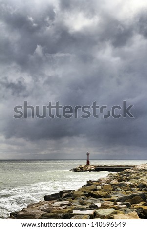 Storm morning at wharf with lighthouse in background